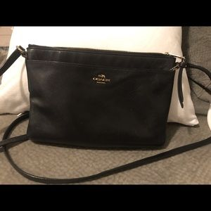 Coach black leather crossbody bag.
